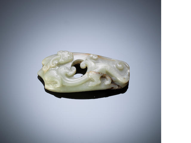 A pale green jade 'she' pendant Qing dynasty