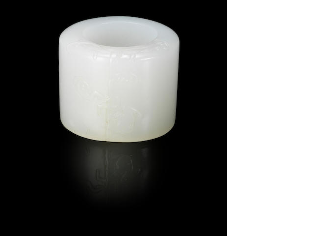 A white jade 'wan' archer's ring Qing dynasty