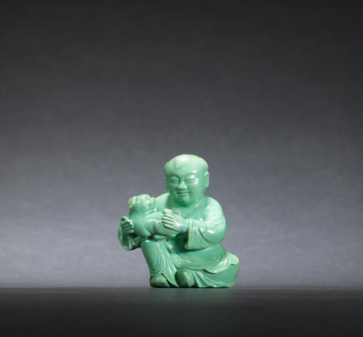 A turquoise matrix boy and dog Qing dynasty