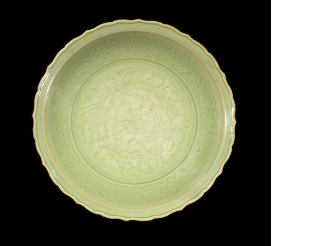 A large Longquan celadon 'peony' barbed charger Early Ming dynasty