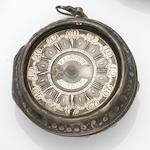 Eriacam, London. A silver key wind repousse pair case pocket watch Case and Movement No.503