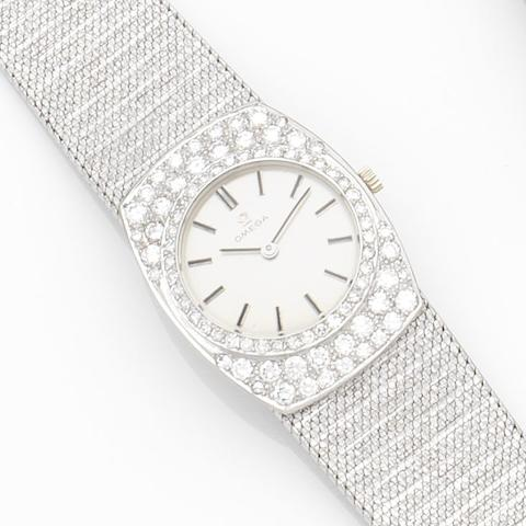Omega. A lady's 18ct white gold and diamond set manual wind bracelet watchMovement No.22127168, Circa 1965
