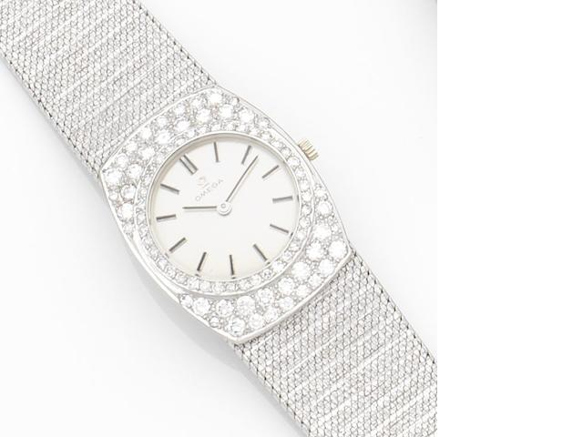 Omega. A lady's 18ct white gold and diamond set manual wind bracelet watch Movement No.22127168, Circa 1965