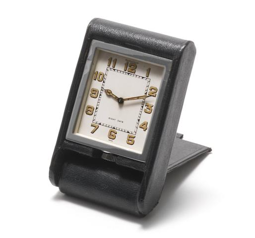 Jaeger-LeCoultre. A chrome plated and calf skin manual wind 8-day travel clock Case No.023256, Circa 1950