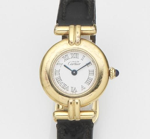 Cartier. A gold plated and silver quartz wristwatch with box and papers Must de Cartier, Case No.673096CC, Sold 7th July 1999