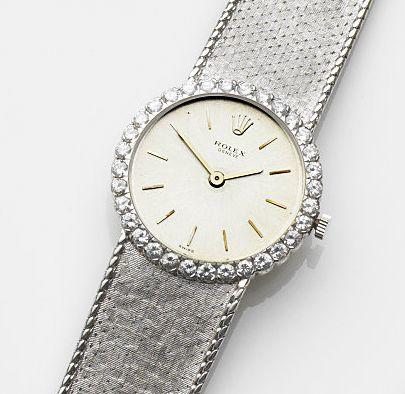 Rolex. A lady's 18ct white gold and diamond set manual wind bracelet watchRef:9941, Case No.843400, Circa 1962