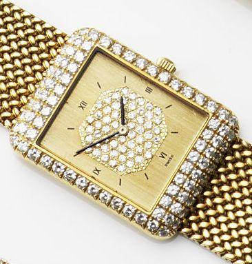 Gerald Genta. An 18ct gold and diamond set manual wind bracelet watchRef:G 1802.7, Case No.16658, Movement No.3425, Circa 1970