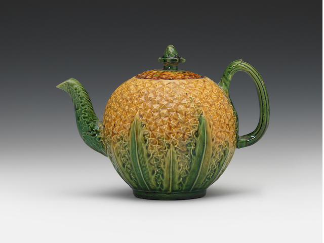A Staffordshire lead-glazed pineapple teapot and cover, circa 1765