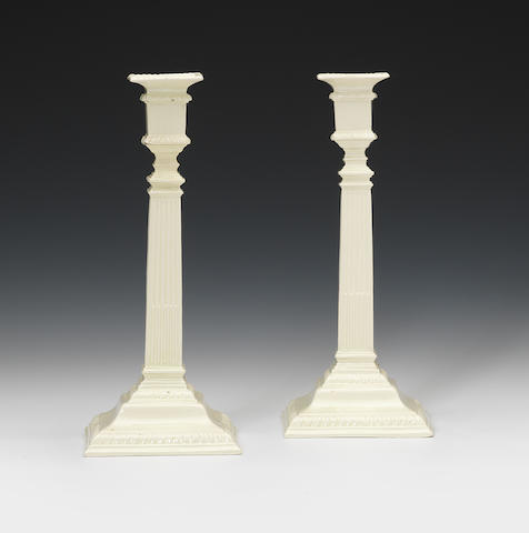 A pair of creamware candlesticks