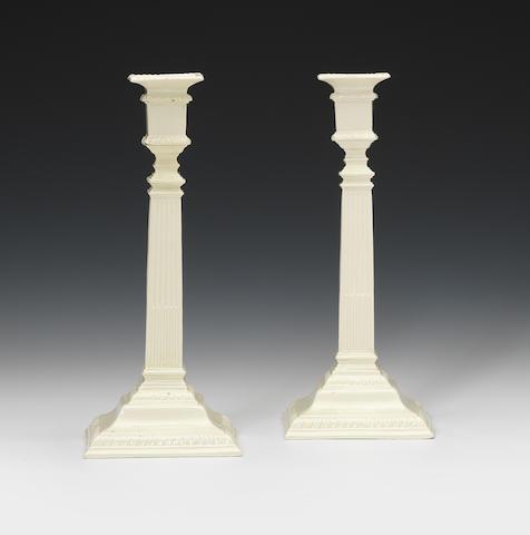 A pair of creamware candlesticks