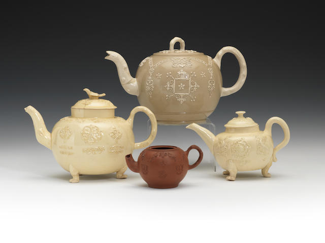 Two creamware teapots and covers, a large saltglaze teapot and cover and a small readware teapot, circa 1750