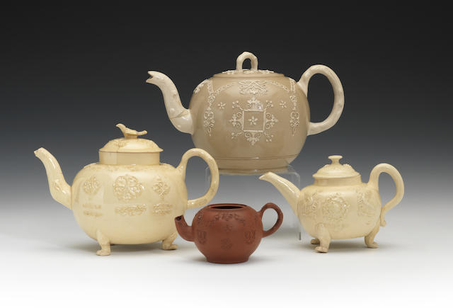 Two Staffordshire creamware teapots and covers, a saltglaze teapot and cover and a redware teapot, circa 1745-55