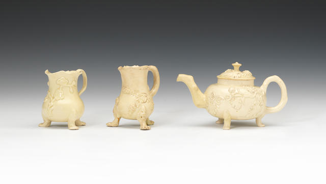 An early creamware teapot and cover and two cream jugs, circa 1750