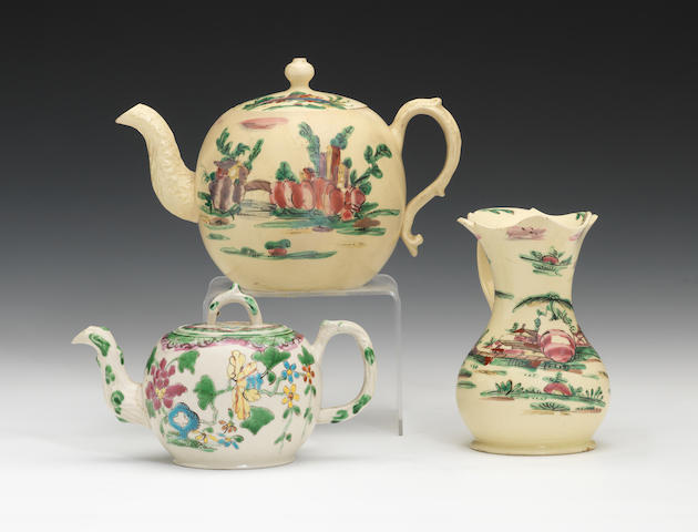 A saltglaze teapot and cover, a creamware teapot and cover and a creamware jug, circa 1760-70