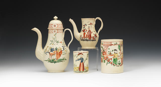 Two coffee pots, one lid, two mugs, all Chinoiserie decorated