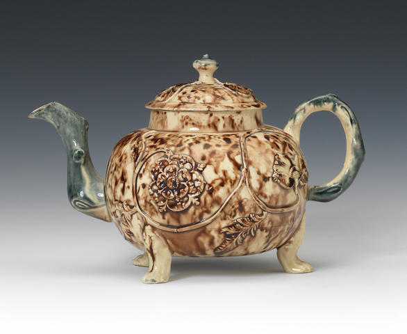 A Staffordshire lead-glazed teapot and cover, circa 1750
