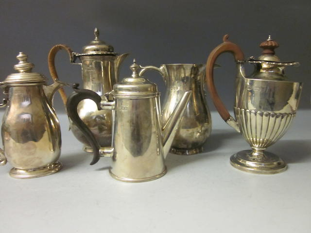 A silver baluster shaped jug, London 1938,  (5)
