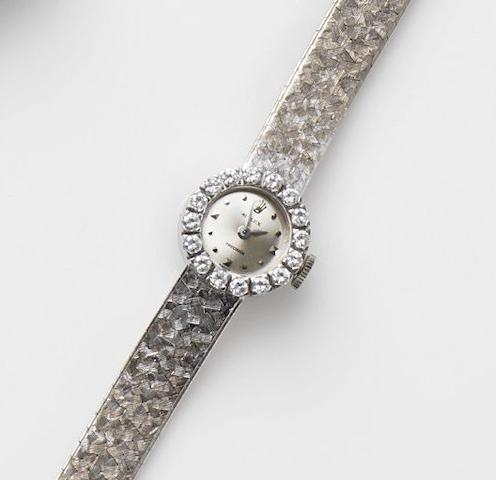 Rolex. A lady's 18ct white gold and diamond set manual wind bracelet watchPrecision, London Hallmark for 1967