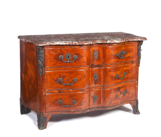 A 19th century Regence style metal mounted walnut parquetry commode en arbalete