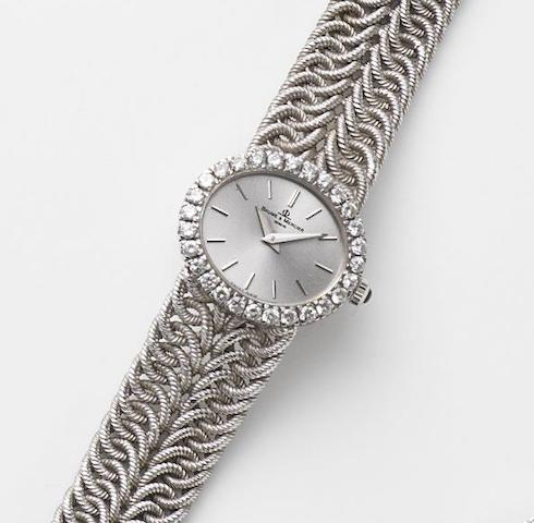 Baume & Mercier. A lady's 18ct white gold and diamond set manual wind bracelet watch Ref:38310 9, Case No.775477, Birmingham Hallmark for 1977