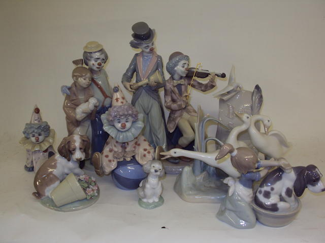 A collection of Lladro clown and animal groups