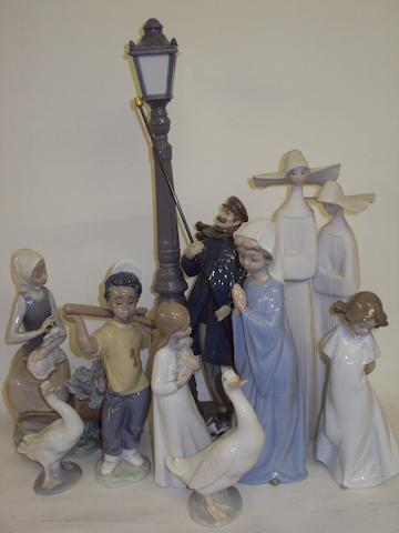 A collection of Lladro and Nao figures