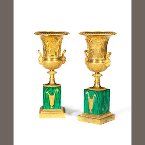 A Pair of Empire style gilt-bronze urns with malachite