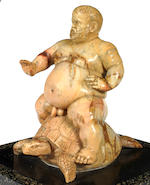 An Italian 19th century Jaune de Sienne marble group of the naked dwarf Morgante riding a turtleafter the 'fontanella del Nano Morgante'