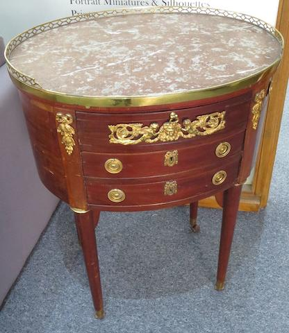 An early 20th century French mahogany and gilt mounted table a ecrire