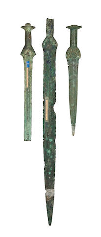 Two North European Bronze Daggers, And A North European Bronze Sword