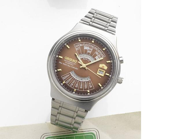 Orient. A stainless steel automatic calendar bracelet watch New Multi-Year Calendar, Case No.46D701-91, Circa 1980