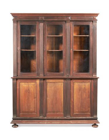 A mid 19th century solid rosewood bookcase probably Brazilian