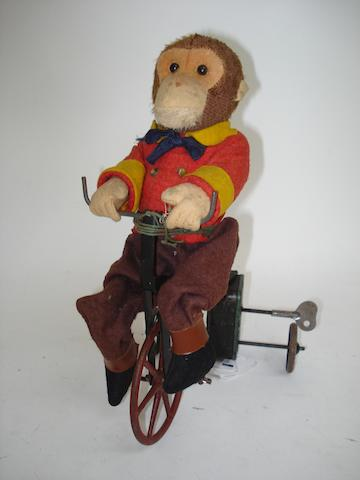 Gebruder Bing Monkey on bike
