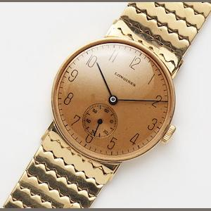 Longines. An 18ct gold manual wind bracelet watch Case and Movement No.6351152, Circa 1943