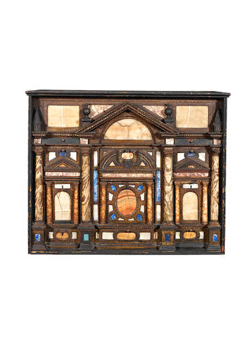 An Italian 17th century pietre dure and gilt tooled and ebonised cabinetinserted in a later frame and raised on a later stand,