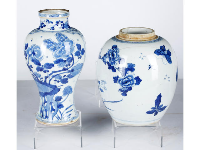 A collection of 18th and 19th Century Chinese blue and white export wares,to include a pair of baluster vases, 23cm high, a brush pot of waisted form, 13cm high, a small gu shaped vase, 19cm high, a ginger jar, 20cm high (lacking cover), a small globular shaped vase, 18cm high, a baluster shaped bottle vase decorated with foliate scrolls, 20cm high, a square shaped container and cover, 17cm high, two circular lidded vessels and covers, a blanc-de-chine figure of Guanyin, 24cm high, two saucer dishes and an assortment of covers and a quantity of carved hardwood stands (all items with some degree of damage)