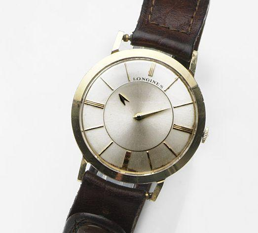 Longines. A 14ct gold manual wind mystery wristwatch Ref:1017, Case No.194162, Movement No.11715628, Circa 1960