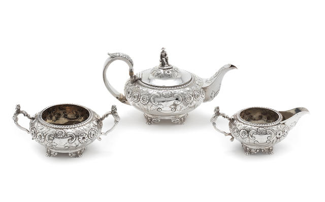 A George IV silver three piece tea service by Thomas Death, London 1825