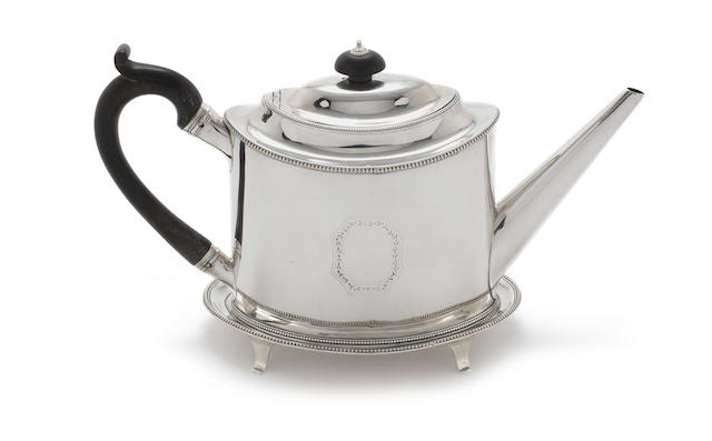 A George III  silver teapot and stand by Peter & Anne Bateman, London 1796