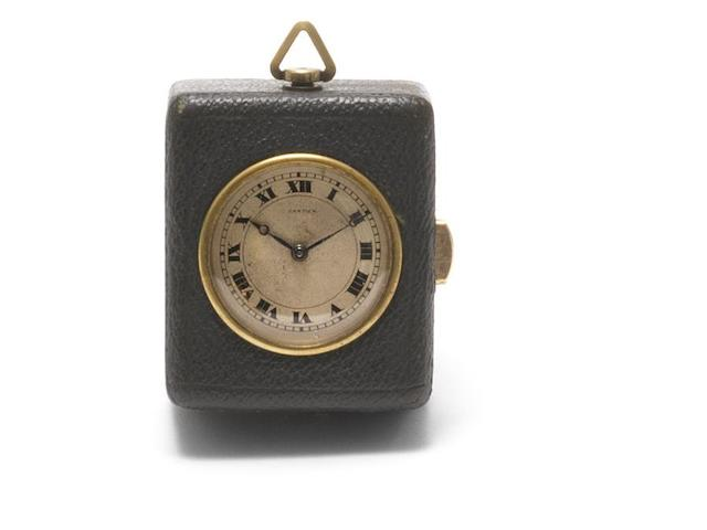 Cartier. A calf skin and gilt metal minute repeating desk clock Movement No.124511, Circa 1930