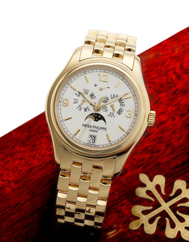 Patek Philippe. A very fine 18ct gold automatic centre seconds wristwatch with annual calendar, moon phases and 48 hour power reserve, together with Certificate of Origin and fitted wooden boxAnnual Calendar, Ref:5146J, Case No.4353336, Movement No.3420048, Sold 18th July 2006