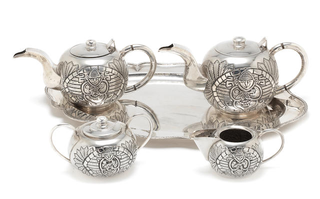 a coffee and tea service, comprising a tray with coffee- and teapot, milkjug and sugarbowl,