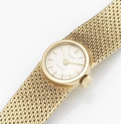 Patek Philippe. A lady's 18ct gold manual wind bracelet watchRef:3266/137, Case No.2634365, Movement No.985344, Retailed by Asprey, Circa 1967