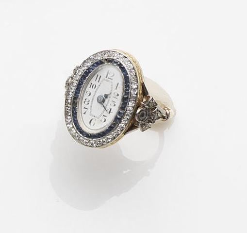 Unsigned. An 18ct gold sapphire and diamond set manual wind ring watchCase No.218915, Circa 1910