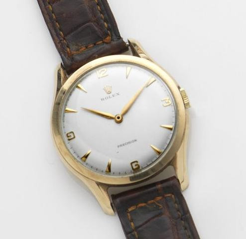 Rolex. A 9ct gold manual wind wristwatchPrecision, Case No.11376, Movement No.16836, London Hallmark for 1960