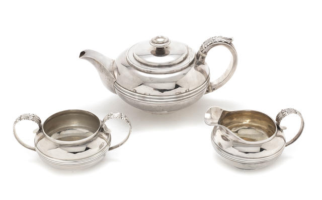 A matched provinicial  silver three-piece tea service the teapot and cream jug, by Barber, Cattle & North, York 1824, the sugar bowl, by Thomas Bradbury & Sons, Sheffield 1936   (3)