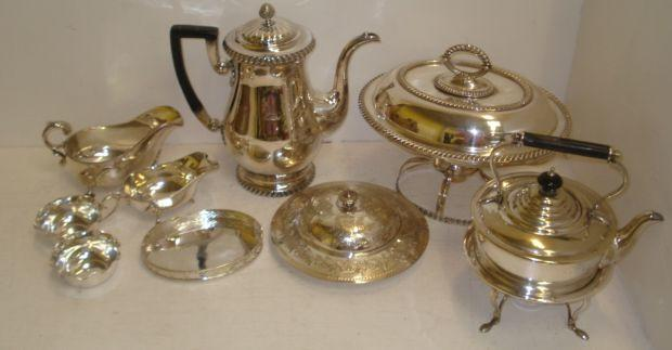 An Old Sheffield plate baluster coffee pot, with gadroon borders, hinged cover, later ebonised handle, engraved with a crest, and electroplate to include and entree dish on warming stand, three rectangular entree dishes, tea kettle on spirit heater stand, two sauce boats, Victorian engraved butter dish with glass liner, egg cruet and other items.