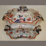 A Victorian Real Ironstone china soup tureen, cover and stand, printed and painted with a Japan pattern, 35cm across twin handles.