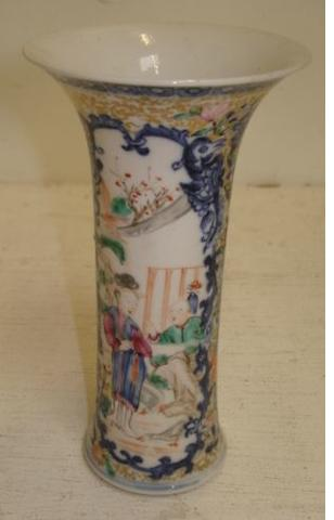 A Chinese 'famille rose' trumpet shape vase, Qianlong, painted with figure panels within a floral ground heightened with gilding, 14cm.