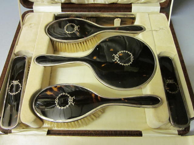 A six piece tortoiseshell and silver dressing table set,  Birmingham 1928,